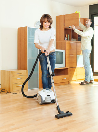 friendly couple  doing housework together in home  photo