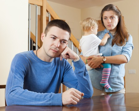 Family  with baby having quarrel at home photo
