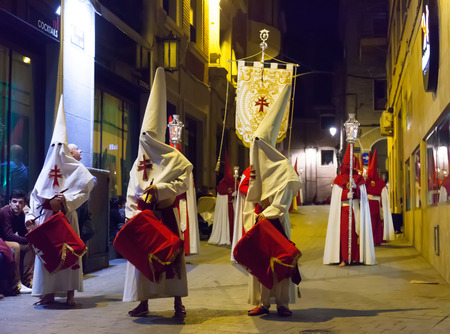 semana santa: MURCIA, SPAIN - APRIL 15, 2014: Evening procession during  Holy Week in Murcia. Semana Santa is  annual commemoration  by Catholic brotherhoods, processions on  streets of  cities