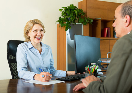 legal office: Elderly man talking with a social worker in the office