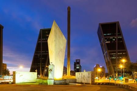 obelisco:  Plaza de Castilla in evening in Madrid. Monument to Calvo Sotelo, Caja Madrid Obelisk and Puerta de Europa Editorial
