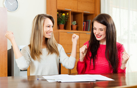 Two business women enjoyed perfect deal in the office photo