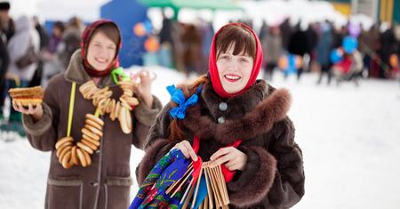 sudarium: Two happy girls celebrating  Pancake Week at Russia Stock Photo