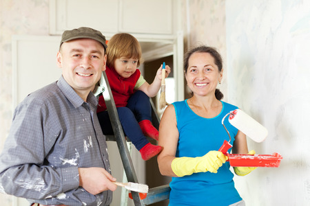 priming brush: Happy family of three makes repairs at home