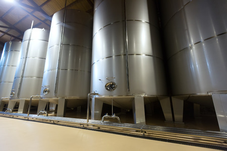 stell: contemporary stell barrels in winery factory
