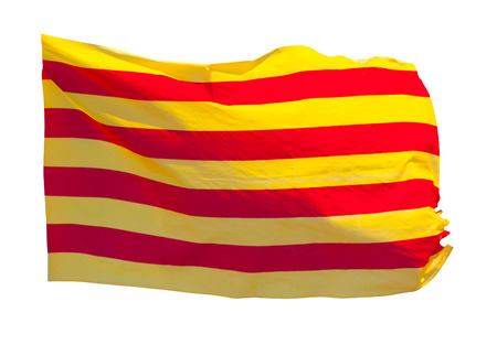 independency: Flag of Catalonia in flight. Isolated over white background