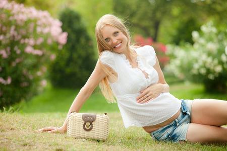 gravida: Portrait of happy pregnancy woman in summer meadow  Stock Photo