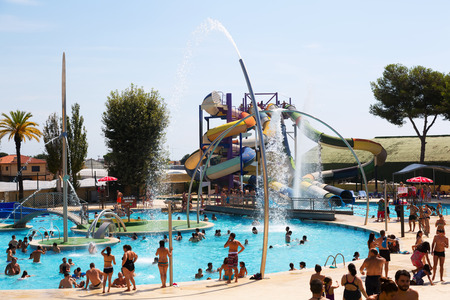 BARCELONA, SPAIN - AUGUST 30, 2014: Attractions at Illa Fantasia  Water Park. It is one of  largest water parks in Europe, with an area over 110,000 square meters