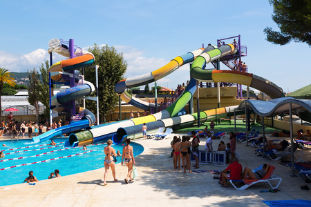 VILASSAR DE DALT, SPAIN - AUGUST 30, 2014: Slides at Illa Fantasia Barcelonas Water Park. 22 Attractions, 3 giant swimming pools and picnic area for  whole family
