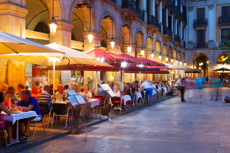 restaurant exterior: night view of Placa Reial  in summer. Barcelona