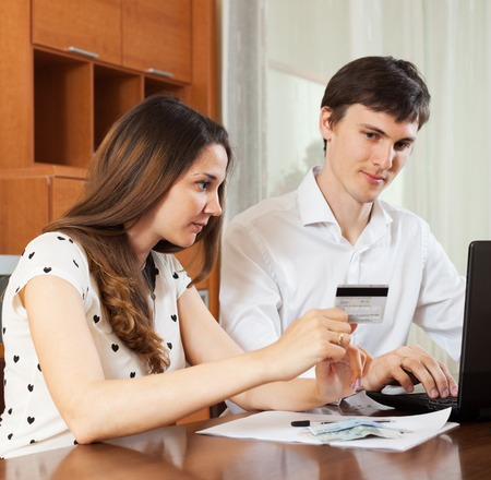 Young couple buying something by internet  photo