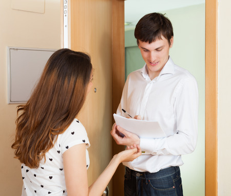 census: Girl talking with employee with paper in door