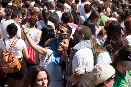 BARCELONA, SPAIN - APRIL 6, 2014: Crowd of people at Festival Holi in Barcelona