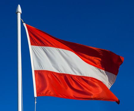 Flag of Austria against blue sky photo