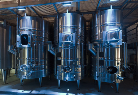 stell: contemporary  large stell barrels in winemaker