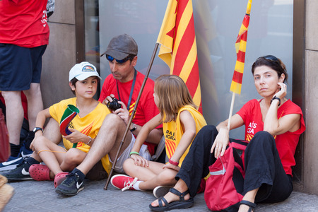 independency: BARCELONA, SPAIN - SEPTEMBER 11, 2014: People waiting  rally to 300th anniversary of  loss of independence of Catalonia