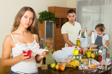 Upset woman with receipt from store, family brought food home  photo
