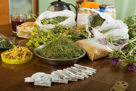 herbs at table in home ready for brews photo