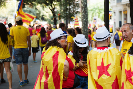 independency: BARCELONA, SPAIN - SEPTEMBER 11, 2014: People converge at rally demanding independence for Catalonia in Barcelona
