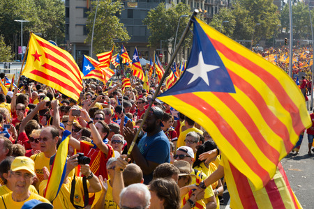 independency: BARCELONA, SPAIN - SEPTEMBER 11, 2014: People at the rally to mark the 300th anniversary of the loss of independence of Catalonia  in Barcelona
