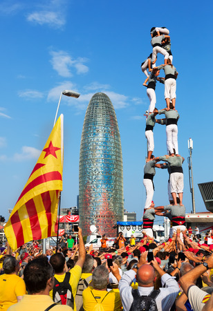 independency: BARCELONA, SPAIN - SEPTEMBER 11, 2014: Castellers performing Castells in  National Day of Catalonia. 300th anniversary of loss of independence of Catalonia  Editorial
