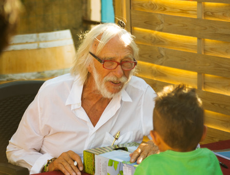 CHATEAU BEL EVEQUE, FRANCE - AUGUST 15, 2014: Pierre Richard autographing in eve of his eightieth birthday at his winery