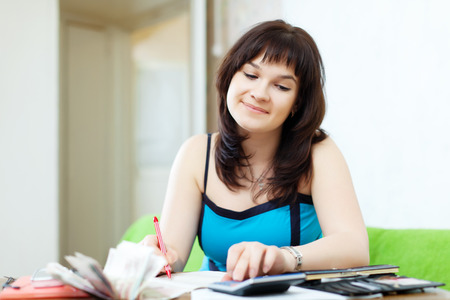 calculated: housewife calculates the family budget at  home Stock Photo