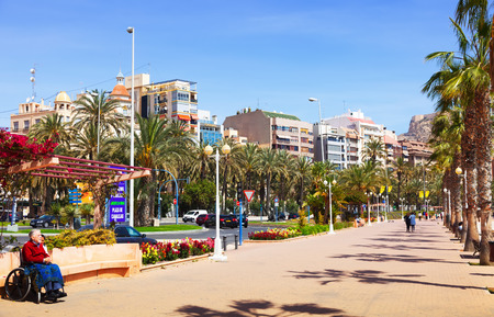 ALICANTE, SPAIN - APRIL 14, 2014: Avenue Admiral July Guillen Tato in Alicante. Place for walking residents and vacationers at seaside