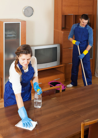Professional cleaners cleaning furniture and floor photo