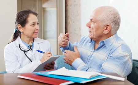 malaise: Sick senior man  complaining to doctor about malaise in interior