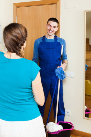 houseman: Girl meeting smiling cleaner at the door at home