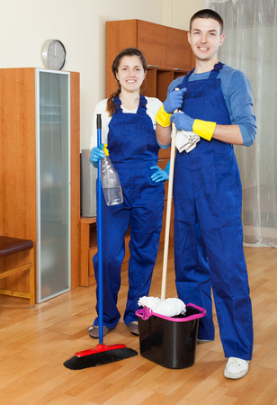 Cleaning premises team cleaning  at home photo