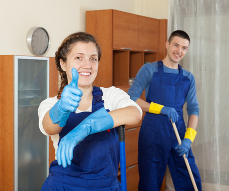 company premises: Happy team of professional cleaners