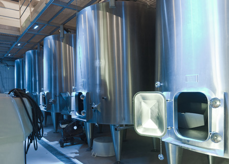 contemporary  large stell barrels in winemaker photo