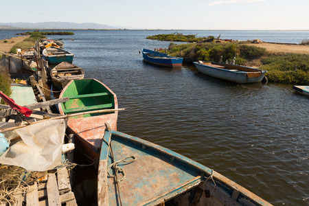 ebre: Old fishing boats at delta of Ebro river in summer Stock Photo
