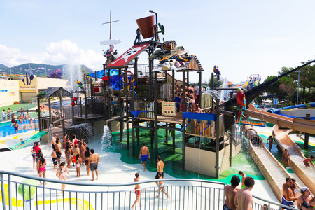 BARCELONA, SPAIN  - AUGUST 30, 2014: Laberint Pitara attraction at Illa Fantasia Water Park. Park contains 22 Attractions, 3 giant swimming pools and picnic area for  whole family