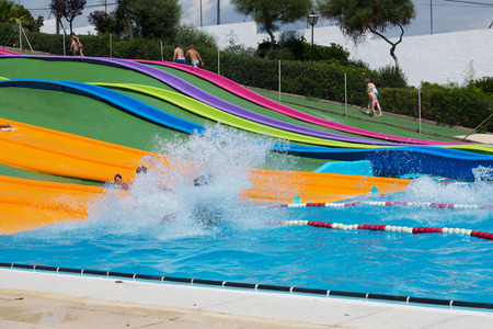 BARCELONA, SPAIN - AUGUST 30, 2014: Water slide at Illa Fantasia waterpark. Illa Fantasia - is one of largest water parks in Europe, with an area over 110,000 square meters