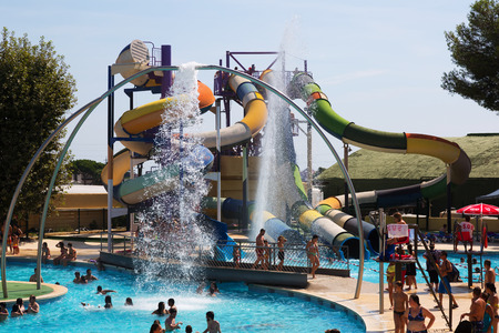 parc: BARCELONA, SPAIN - AUGUST 30, 2014: Water slide at Illa Fantasia  Water Park. Illa Fantasia - this is one of  largest water parks in Europe
