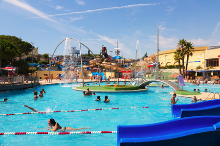 BARCELONA, SPAIN - AUGUST 30, 2014: Water attractions at Water Park in summer. Illa Fantasia - is one of largest water parks in Europe, with an area over 110,000 square meters