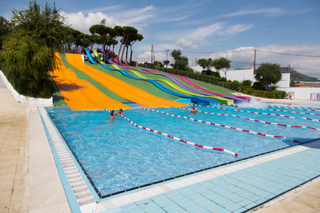 BARCELONA, SPAIN - AUGUST 30, 2014: Water slide at waterpark in summer. Illa Fantasia - is one of largest water parks in Europe