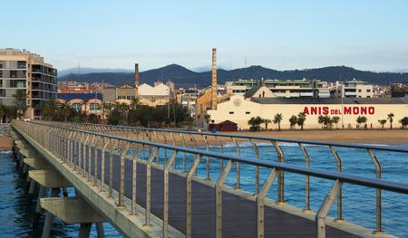 fabrica: BADALONA, SPAIN - OCTOBER 10, 2014: View with fabrica of Anis del Mono - registered trademark of anise popular Spanish origin brand