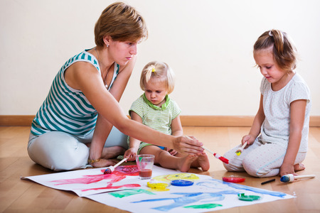 2 3 years: Mother and siblings painting with paint  indoor Stock Photo