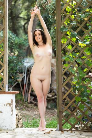 nude girl young: Smiling naked girl posing in summer garden Stock Photo