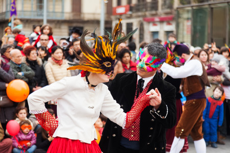 mummery: BARCELONA, SPAIN - MARCH 2, 2014: Dancing people at Carnival Balls to the Popular Culture and Traditional Catalan during La Taronjada