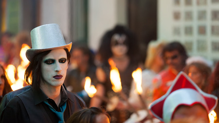 mummery: SITGES, CATALONIA - MARCH 5, 2014: Unidentified person at procession of burial Carnestoltes  at Sitges Editorial