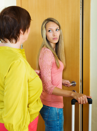 daughter in law: Upset girl with suitcase leaving apartment of mother
