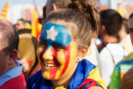 independency: BARCELONA, SPAIN - SEPTEMBER 11, 2014: Unidentified Catalan  girl with  pattern of  Catalan Flag in  National Day of Catalonia, Barcelona