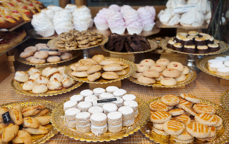 Different fresh cakes at shop window photo