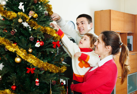 family   preparing for Christmas at living room photo