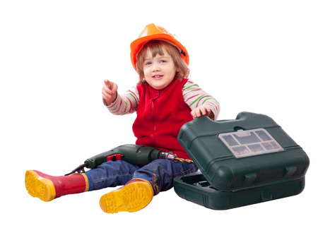 Little builder in hardhat with tools. Isolated over white photo